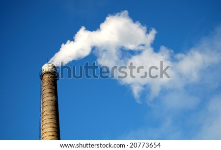 Chimney and white smoke on blue sky