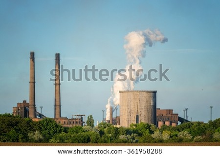 Chimney of a Power plant against blue sky