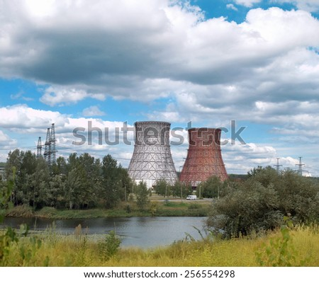 chimney power plant against the sky and river - stock photo