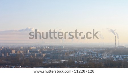 Chimney-stalks pollute atmosphere. Smoke on the city. - stock photo