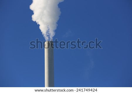 Chimney with Smoke at Power Station - stock photo