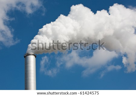 chimney with white dense smoke - stock photo