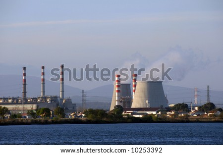 Chimneys of nuclear power plant, cooling towers emitting steam