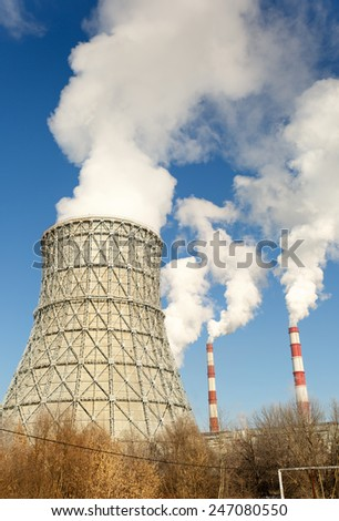 Chimneys of nuclear power plant. View on nuclear power plant - stock photo