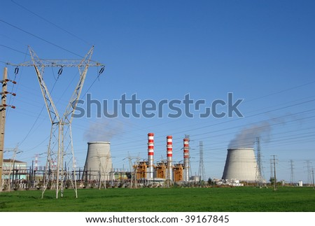 Chimneys of power plant, cooling towers emitting steam