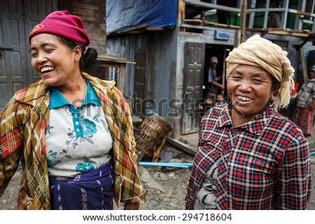 CHIN STATE, MYANMAR - JUNE 23 2015: Friendly ladies in village popular for selling apples in the recently opened to foreigners area of Chin State - western Myanmar (Burma) - stock photo