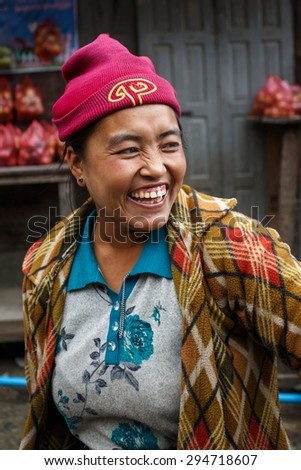 CHIN STATE, MYANMAR - JUNE 23 2015: Friendly lady in village popular for selling apples in the recently opened to foreigners area of Chin State - western Myanmar (Burma)