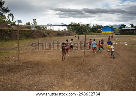 CHIN STATE, MYANMAR - JUNE 22 2015: Local boys play footbal in the recently opened for tourists Chin State Mountainous Region, Myanmar (Burma) - stock photo