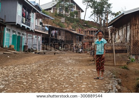 CHIN STATE, MYANMAR - JUNE 22 2015: Local village child in the recently opened for tourists Chin State Mountainous Region, Myanmar (Burma) - stock photo