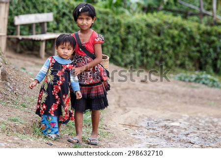 CHIN STATE, MYANMAR - JUNE 22 2015: Local village girls in the recently opened for tourists Chin State Mountainous Region, Myanmar (Burma) - stock photo
