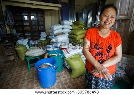 CHIN STATE, MYANMAR - JUNE 18, 2015: Rice warehouse in the recently opened for tourists Chin State Mountainous Region, Myanmar (Burma) - stock photo
