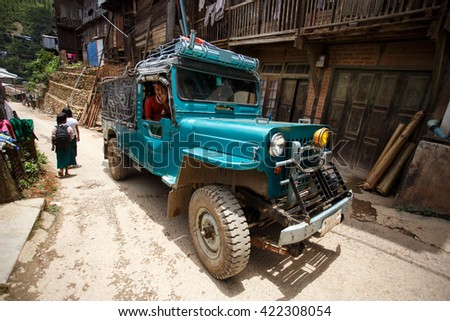 CHIN STATE, MYANMAR - JUNE 18 2015: $X$ Driving through the recently opened for tourists Chin State Mountainous Region, Myanmar (Burma) - stock photo