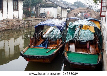 China/ancient water town/Zhouzhuang: two boats