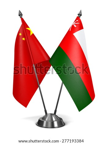 China and Oman - Miniature Flags Isolated on White Background. - stock photo