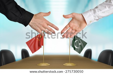 China and Pakistan diplomats agreeing on a deal - stock photo