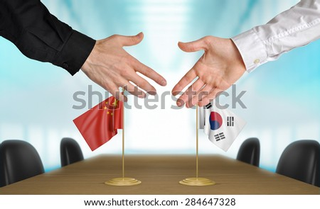 China and South Korea diplomats agreeing on a deal - stock photo