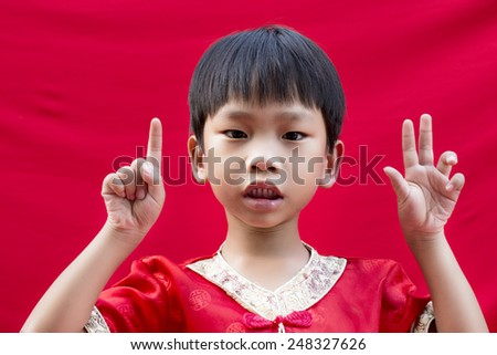 China boy traditional chinese red tang stock photo royalty free china boy in traditional chinese red tang suit greeting m4hsunfo