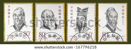 """CHINA - CIRCA 2000: A set of stamps printed in China shows Mozi, Laozi, Confucius, and Zhuangzi, from the series of """"Chinese Ancient Thinker"""", circa 2000 - stock photo"""