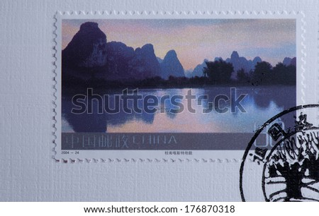 CHINA - CIRCA 2004:A stamp printed in China shows image of China 2004-24 Frontier Scenes of China Stamps Landscape Karst landscape in Southern Guangxi,circa 2004 - stock photo