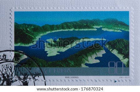 CHINA - CIRCA 2004:A stamp printed in China shows image of China 2004-24 Frontier Scenes of China Stamps Landscape Lake in the Yalu river basin,circa 2004 - stock photo