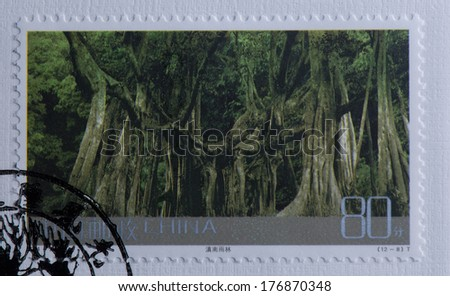 CHINA - CIRCA 2004:A stamp printed in China shows image of China 2004-24 Frontier Scenes of China Stamps Landscape Rain Forest in Southern Yunnan,circa 2004 - stock photo