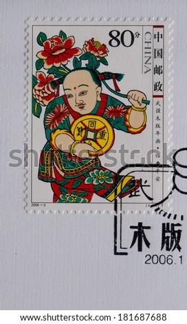 CHINA - CIRCA 2006:A stamp printed in China shows image of China 2006-2 Wuqiang Woodcut New Year Art,circa 2006 - stock photo
