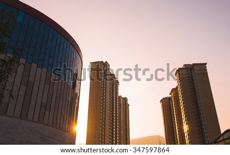 china city and buildings with sunset - stock photo