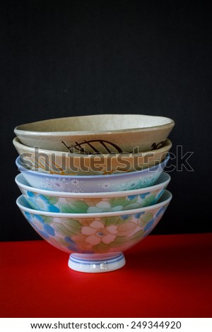 China crockery and chopsticks on red paper background