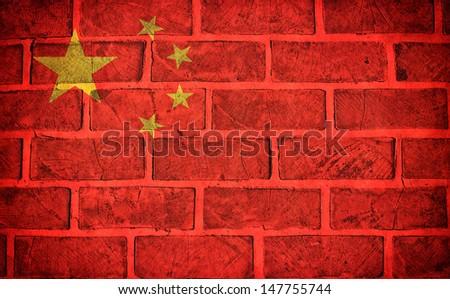 China flag on the old wall bricks - stock photo