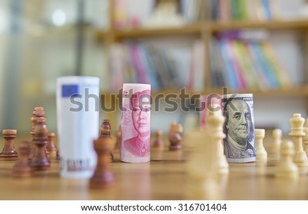 China's yuan vs US dollar in chess concept - stock photo