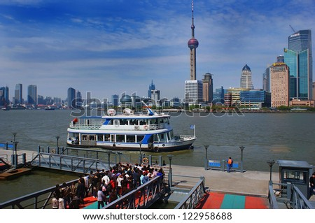 CHINA, SHANGHAI - APRIL 25 - River tram on the embankment  Zhongshan Dong Lu of the Huangpu river with view of the financial center Pudong and the TV tower on April 25, 2010 in Shanghai.