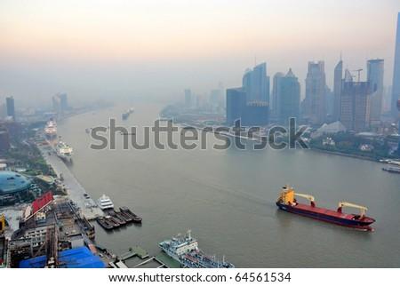 China Shanghai  Huangpu river and Pudong skyline at sunset. - stock photo