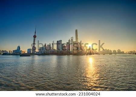 China Shanghai Pudong district Skyline during sunrise - stock photo