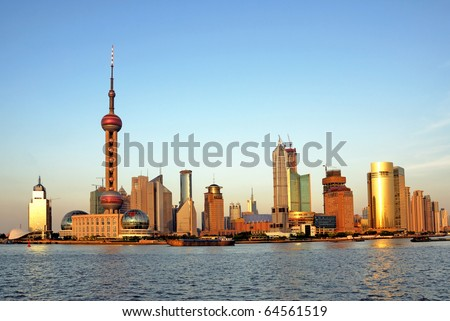 China Shanghai the huangpu river and Pudong skyline at sunset. - stock photo