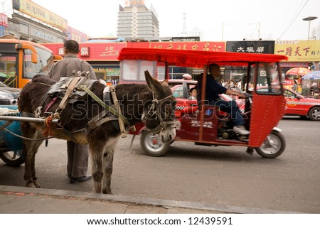 China. Street. In the foreground  a donkey. - stock photo