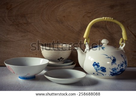 China tea set with old cup put on vintage white table still life image - stock photo