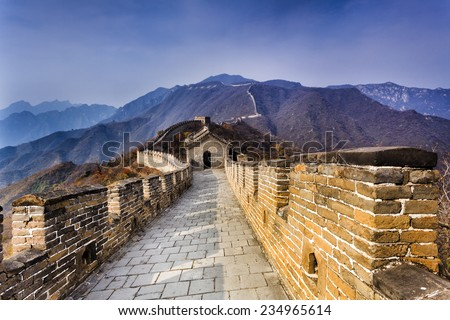 China The Great wall fragment near Mutianyu high in mountains north from Beijing perspective view along cobblestone  - stock photo
