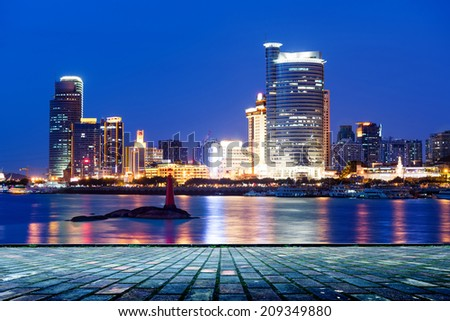 China Xiamen city night, seaside skyscrapers. - stock photo