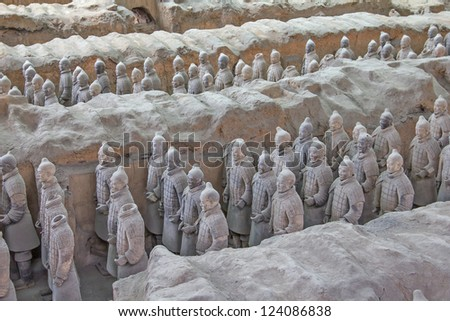 CHINA, XIAN - MAY 30: Terra cotta warriors excavation are displayed on 30 May 2011 in Xian, China. The statue army, discovered in 1974, has been created to protect the First Qin Emperor's Mausoleum. - stock photo