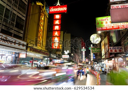 CHINATOWN, BANGKOK, THAILAND - Apr 27, 2017: At China Town bangkok cars light trail and shops and a lot off people at night time