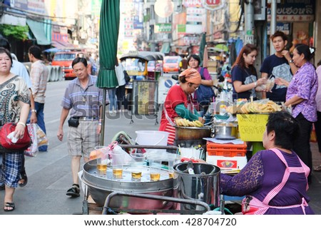 CHINATOWN, BANGKOK,THAILAND-24 APRIL, 2016:street food at Yaowarat Road. Yaowarat road is various products such as street food, gold shop.Restaurant,etc., Famous and Popular destinations for tourists. - stock photo