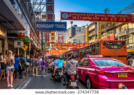 CHINATOWN, BANGKOK, THAILAND - FEBRUARY 6, 2016 : Cars and shops on Yaowarat road, the main street of China town.