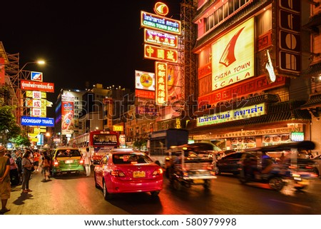 CHINATOWN, BANGKOK THAILAND - FEBRUARY : Cars and shops on Yaowarat road, the main street of China town in Bangkok, Thailand on February 15, 2017