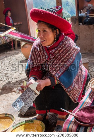 CHINCHERO, PERU - MARCH 9, 2015: Peruvian woman dressed in  traditional clothes while working on a homemade wool  industry using traditional techniques.
