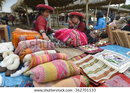 CHINCHERO, PERU - SEPTEMBER 20: Peruvian woman dressed in traditional clothes while working on a homemade wool industry using traditional techniques on September 20, 2015 in Chinchero, Peru.