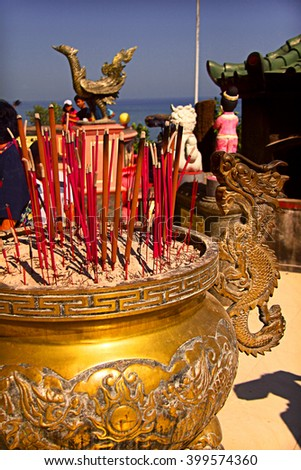 Chinese Altar with many incense at a chinese temple