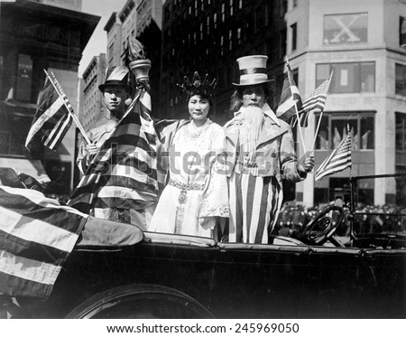 Chinese Americans in the Fourth Liberty Loan Campaign parade. They are costumed as China, Lady Liberty, and Uncle Sam during WWI. New York City. Oct. 1, 1918.