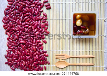Chinese and Asian dessert beans and preserved fruits in hot sirup - stock photo