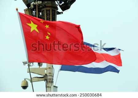 Chinese and Flags Weaving the Wind - stock photo