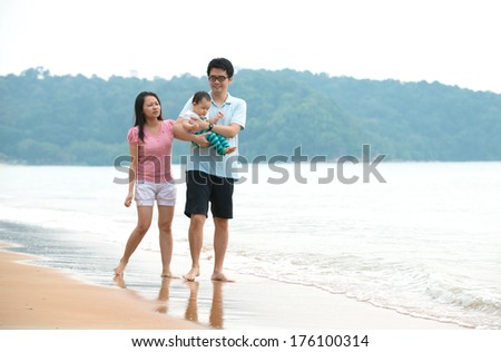 chinese asian Family walking On the Beach  - stock photo